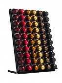 Ratingen, Germany - February 11, 2011: Assortment of Nespresso capsules in display, isolated on white background. Nespresso machines brew espresso from special capsules containing ground coffee.