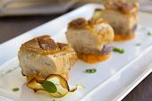 stock photo of pork belly  - Delicious roasted pork belly cubes on baked pumpkin with fried apple chips and a cauliflower puree with organo and sage - JPG