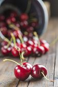 Little Brass Bucket Of Cherries On A Table