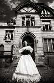 Mysterious woman in a white Victorian dress