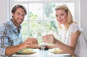Cute smiling couple having a meal together at home in the dining room