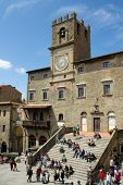 Tourists in front of City hall of Cortona, Tuscany