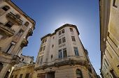 Vintage building facades in Old havana street against blue sky