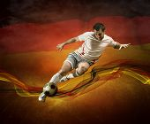 Abstract waves aroun soccer player on the national flag of Germany