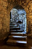 foto of stepping stones  - Stone arch and steps in underground castte - JPG