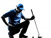 one man golfer golfing crouching in silhouette studio isolated on white background