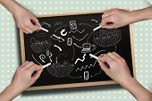 Composite image of multiple hands drawing brainstorm with chalk against blackboard