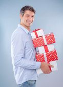 man holding presents for christmas