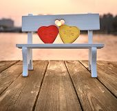 concept of Valentine's Day , two hearts on a park chair