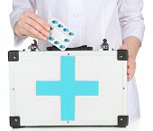 Nurse holding first aid kit, isolated on white