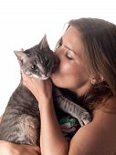 Smiling Beautiful Brunette Kissing And Petting Her Cute Grey Cat