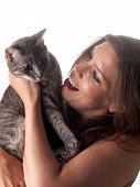 Smiling Beautiful Brunette Holding And Petting Her Cute Grey Cat