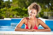 beautiful sexy female model posing by the pool, outdoor portrait