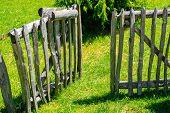 Open door in wooden fence