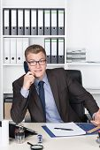 Young Shocked Businessman Is Phoning In The Office