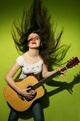 Young Woman Wildly Playing Guitar