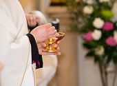 Catholic Priest Granting The Communion