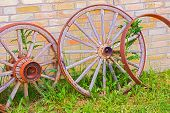 Abandoned Faded Wooden Cart Wheels Together