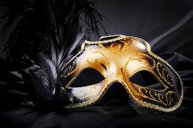stock photo of mardi gras mask  - Ornate carnival mask on black silk background - JPG