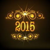 Stylish golden text 2015 with beautiful and shiny floral design for Happy New Year celebrations on brown background.