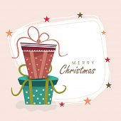Merry Christmas celebration concept with colorful gift boxes and stylish text in star decorated frame.