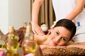Chinese Asian woman in wellness beauty spa having aroma therapy massage with essential oil, looking relaxed