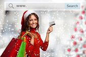 Christmas dressed woman showing her credit card while shopping