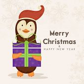Cute cartoon of a penguin holding gift box on snowflakes decorated background for Merry Christmas and Happy New Year celebrations .