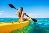 Woman Kayaking in the Ocean on Vacation in Hawaii