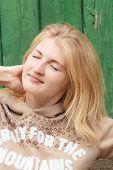 Portrait of green-eyed dreaming blonde girl