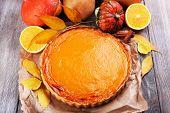 Homemade pumpkin pie on wooden background