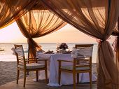 Romantic dinner setting on the beach
