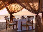 Romantic dinner setting on the beach