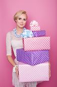 Beautiful happy woman with a colorful gift boxes. Soft colors. Christmas, birthday, Valentine day