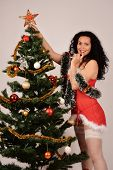 Christmas sexy beautiful girl, with tree and gifts