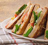 Club sandwich with chicken and ham