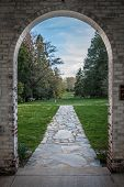 Pastoral View through Brick Archway