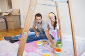 Cute couple about to paint living room in their new home