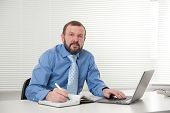 Mature Businessman Working On His Laptop