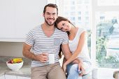 Young couple having coffee together at home in the kitchen