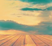sunset sky and wood floor, retro filtered, instagram style