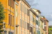An image of a row of houses in Pisa Italy