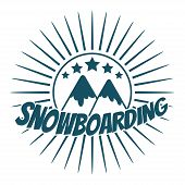 Flat snowboarding with mountains.