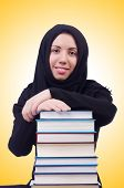 picture of burka  - Young muslim female student with books - JPG