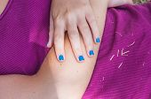 Blue Enamel For Nails Of A Young Girl