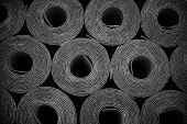 picture of membrane  - Closeup of Rolls of new black roofing felt or bitumen - JPG