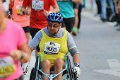 Senior Man In A Wheel Chair Racing