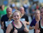 Smiling Blonde Woman Running