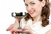 Photo of smiling woman with metal snifter