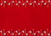 Christmas Lollipop Ornaments on Red Textured Background